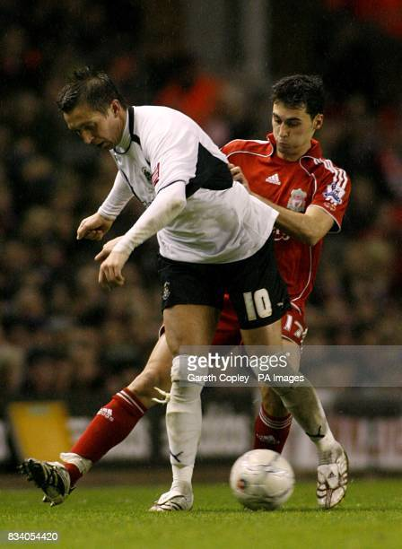 Luton Town's Darren Currie and Liverpool's Alvaro Arbeloa battle for the ball
