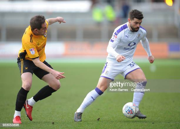 Luton Town's Elliot Lee under pressure from Newport County's Matt Dolan during the Sky Bet League Two match betweenNewport County and Luton Town at...