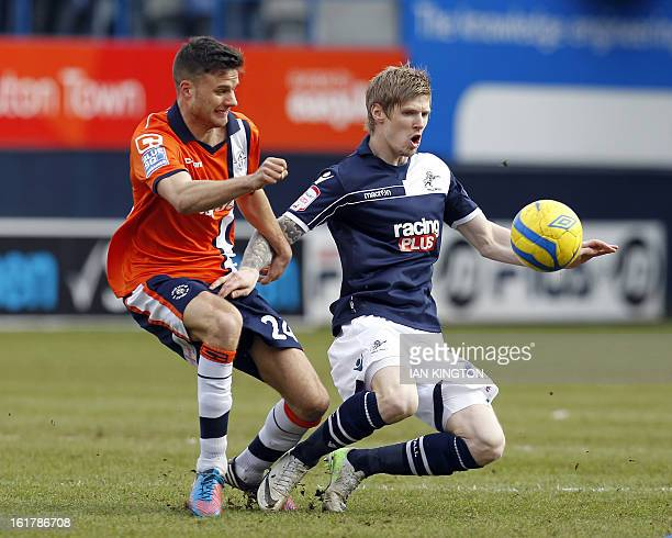 Luton Town's English midfielder Jonathan Smith vies with Millwall's Irish striker Andy Keogh during the English FA Cup fifth round football match...