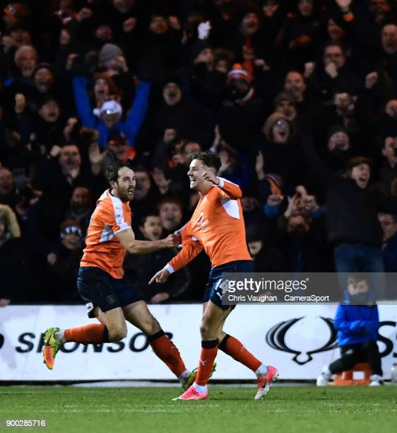 Luton Town's Harry Cornick right celebrates scoring his sides fourth goal with teammate Danny Hylton during the Sky Bet League Two match between...