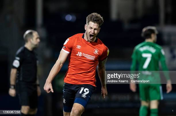 Luton Town's James Collins celebrates completing a hat trick by scoring his side's third goal during the Sky Bet Championship match between Luton...