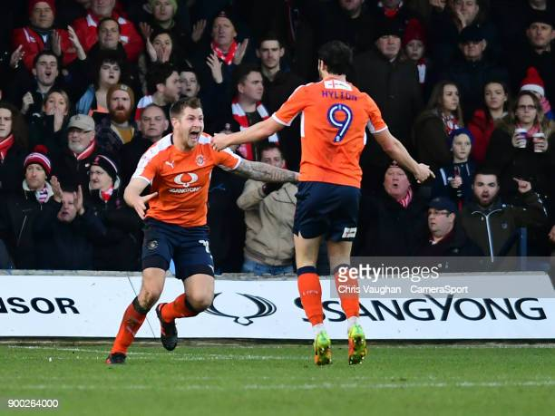 Luton Town's James Collins left celebrates scoring his sides equalising goal to make the score 11 with teammate Danny Hylton during the Sky Bet...