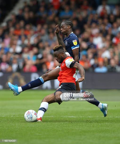Luton Town's Kazenga LuaLua and Huddersfield Town's Terence Kongolo during the Sky Bet Championship match between Luton Town and Huddersfield Town at...