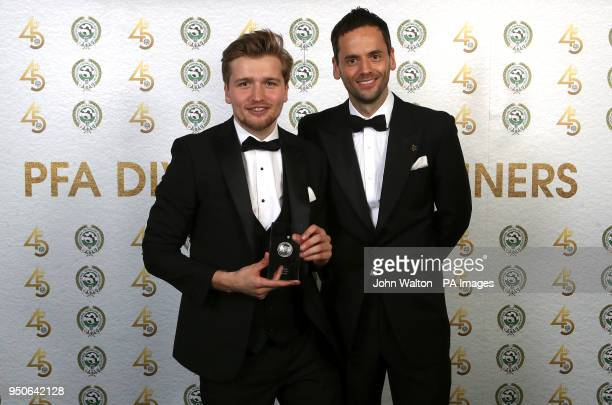 Luton Town's Luke Berry and PFA chairman Ben Purkiss poses with the PFA League Two Team of the Year award during the 2018 PFA Awards at the Grosvenor...