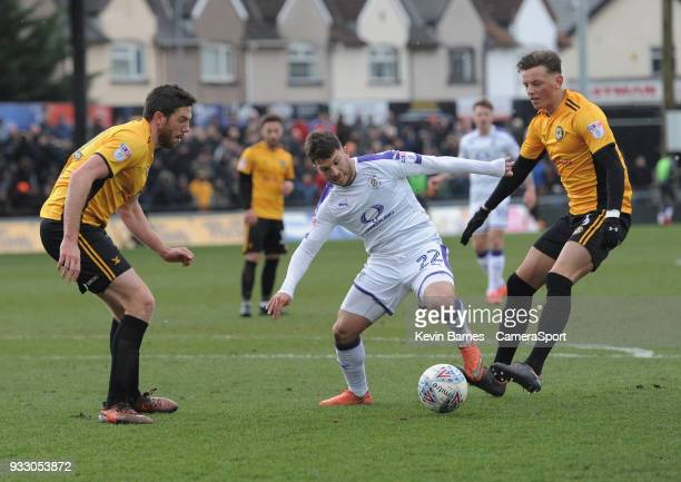 Luton Town's Luke Gambin under pressure from Newport County's Ben White during the Sky Bet League Two match betweenNewport County and Luton Town at...