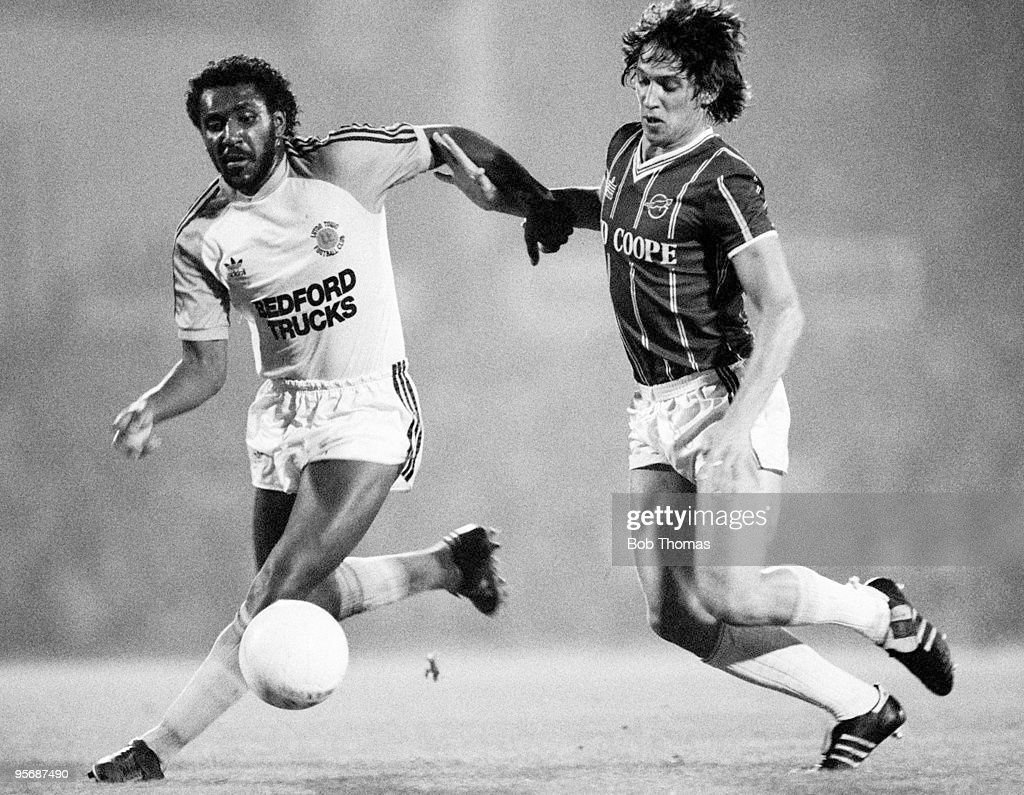 Luton Town's Ricky Hill (left) clashes with Leicester City's Gary Lineker during a Division 1 football match held at Filbert Street Stadium, Leicester on 31st August 1983. Luton Town won 3-0. (Bob Thomas/Getty Images).