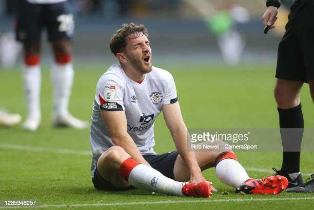 Luton Town's Tom Lockyer in pain after picking up an injury in the first half during the Sky Bet Championship match between Millwall and Luton Town...