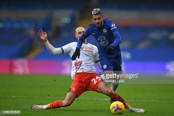 Luton Town's Welsh defender Rhys Norrington-Davies slides in to tackle Chelsea's Brazilian-Italian defender Emerson Palmieri during the English FA...