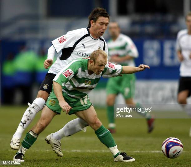 Luton's Darren Currie challenges Yeovil's Darren Way during the CocaCola Football League One match at Kenilworth Road Luton