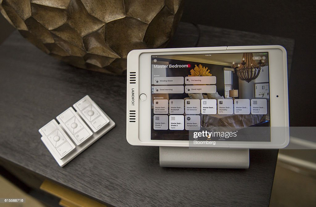 Lutron Electronics Co. Pico remote wireless controllers and an Apple Inc. iPad displaying smart home functions sit on display inside a home at the Lennar Corp. Marina Shores development in Alameda, California, U.S., on Monday, Oct. 17, 2016. As iPhone sales growth slows, Apple Inc. is teaming up with a handful of builders to inch its way into the market for Internet-connected home furnishings, a nascent field that has attracted rivals like Alphabet Inc.s Google and Amazon.com. Photographer: David Paul Morris/Bloomberg via Getty Images