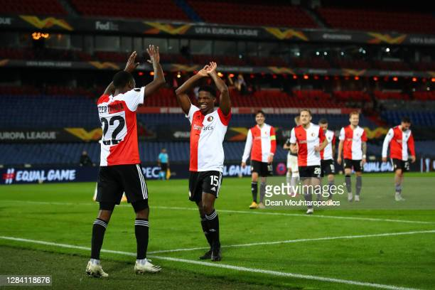 Lutsharel Geertruida of Feyenoord celebrates with Tyrell Malacia of Feyenoord after scoring his team's third goal during the UEFA Europa League Group...