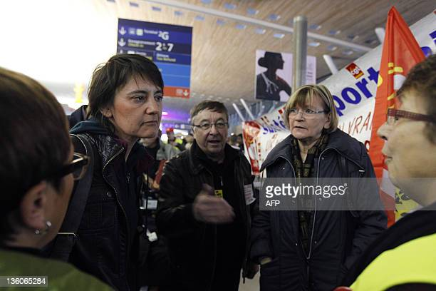 Lutte Ouvriere trotskyist candidate for France's 2012 presidential election Nathalie Arthaud and communist MP MarieGeorge Buffet speak with striking...
