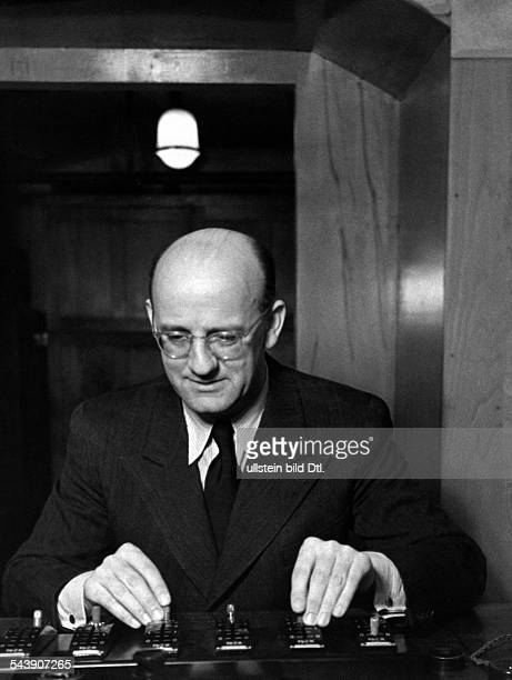 Lutter Adalbert Musician Conductor Germany*20101896 on the mixing console Photographer Ullmann Published by 'Hier Berlin' 21/1940Vintage property of...