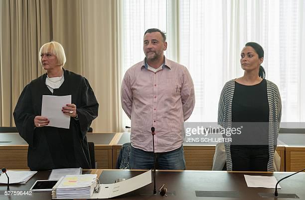 Lutz Bachmann cofounder of Germany's xenophobic and antiIslamic PEGIDA movement stands between his lawyer Katja Reichel and his wife Vicky Bachmann...