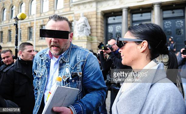 Lutz Bachmann founder of Germany's xenophobic and antiIslamic PEGIDA movement and his wife Vicky Bachmann have their eyes covered as if pixelized by...