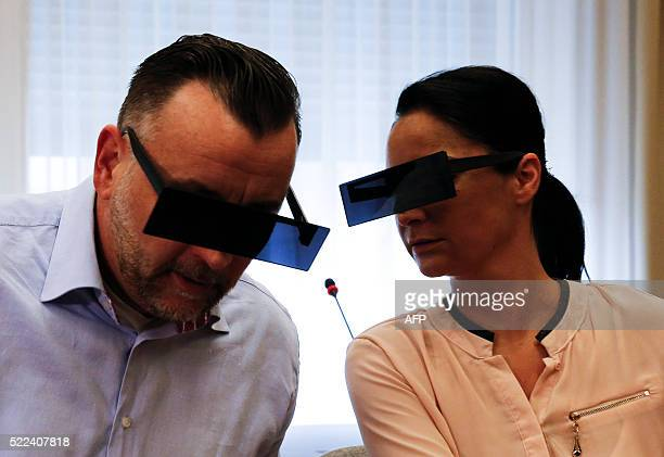 Lutz Bachmann founder of Germany's xenophobic and antiIslamic PEGIDA movement and his wife Vicky have their eyes covered as if pixelized by media in...
