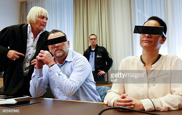 Lutz Bachmann founder of Germany's xenophobic and antiIslamic PEGIDA movement has his eyes covered as if pixelized by media as he sits next to his...