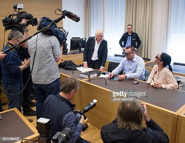 Lutz Bachmann founder of Germany's xenophobic and antiIslamic PEGIDA movement waits waits together with his lawyer Katja Reichel and his wife Vicky...
