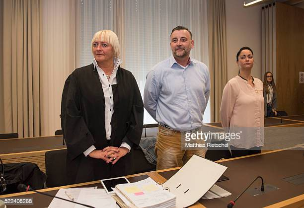 Lutz Bachmann founder of the Pegida movement center his advocate Katja Reichel left and his wife Vicky right at the beginning of the first day of his...