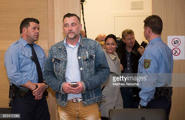 Lutz Bachmann left founder of the Pegida movement his wife Vicky behind arrive to the courtroom after a break on the first day of his trial to face...