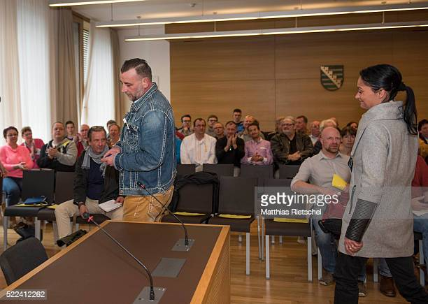 Lutz Bachmann left founder of the Pegida movement his wife Vicky right arrive to the courtroom after a break on the first day of his trial to face...