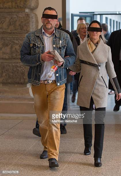 Lutz Bachmann wearing black glasses founder of the Pegida movement and his wife Vicky arrives for the first day of his trial to face charges of hate...