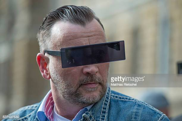 Lutz Bachmann wearing black glasses founder of the Pegida movement arrives for the first day of his trial to face charges of hate speech on April 19...