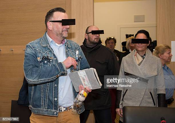 Lutz Bachmann wearing black glasses founder of the Pegida movement and his wife Vicky right arrive for the first day of his trial to face charges of...