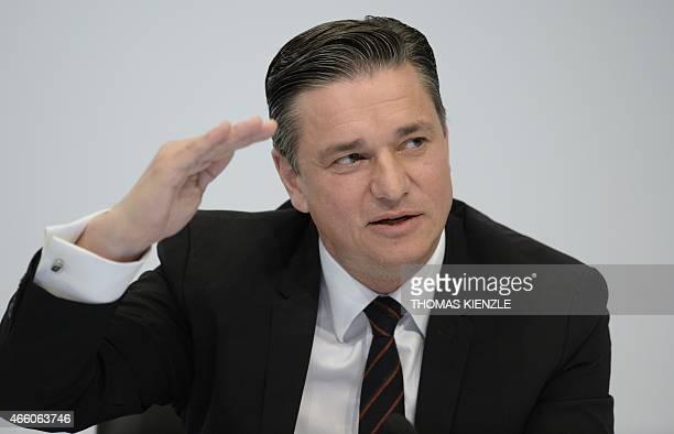 Lutz Meschke CFO of German car maker Porsche AG attends the company's annual press conference at the Porsche museum in Stuttgart southwestern Germany...