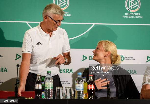 Lutz Michael Fröhlich chairman of the DFB referee commission Elite and referee Bibiana Steinhaus attend a press conference of the Deutscher...