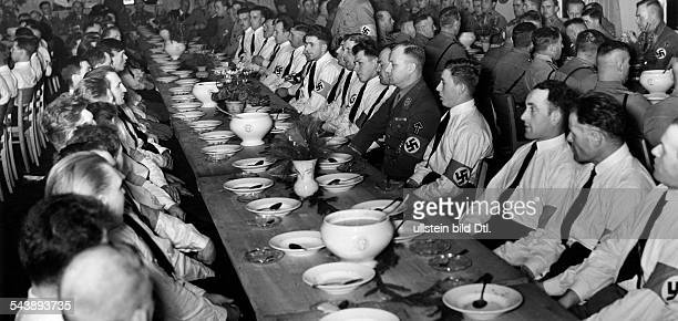 Lutze Viktor Officer SAcommander Germanyvisiting the Volkswagen factory in Fallersleben Lutze heaving lunch with workers and members of the SA 1939...