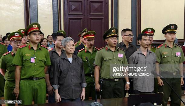 Luu Van Vinh and other activists who were charged of subversion stand trial in Ho Chi Minh city on October 5 2018 A Vietnamese court on October 5...