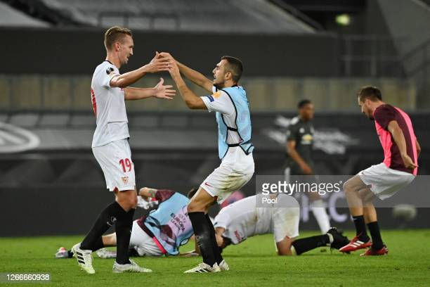 Luuk de Jong and Joan Jordan of Sevilla FC celebrate following their sides victory in the UEFA Europa League Semi Final between Sevilla and...