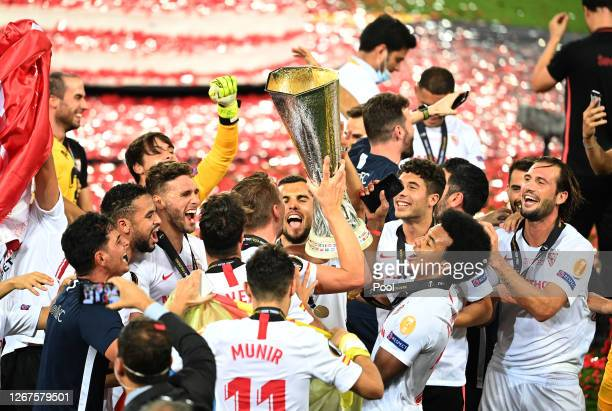 Luuk de Jong, Joan Jordan, Jose Mena, Jules Kounde of Sevilla, and their teammates celebrate with the UEFA Europa League Trophy following their...
