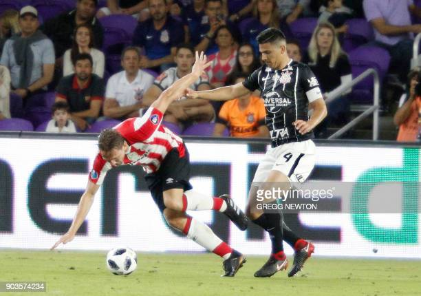 Luuk De Jong of Dutch club PSV Eindhoven is challenged by Balbuena of Brazilian club Corinthians during their Florida Cup soccer game at Orlando City...