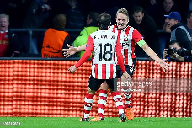 Luuk de Jong of Eindhoven celebrates the second goal with Andres Guardado of Eindhoven during the UEFA Champions League Group B match between PSV...