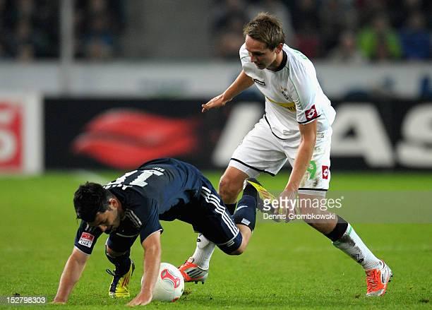 Luuk de Jong of Moenchengladbach challenges Tolgay Arslan of Hamburg during the Bundesliga match between Borussia Moenchengladbach and Hamburger SV...