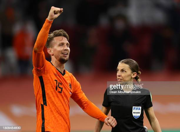 Luuk de Jong of Netherlands celebrates after scoring their team's second goal as Referee Stephanie Frappart looks on during the FIFA World Cup 2022...