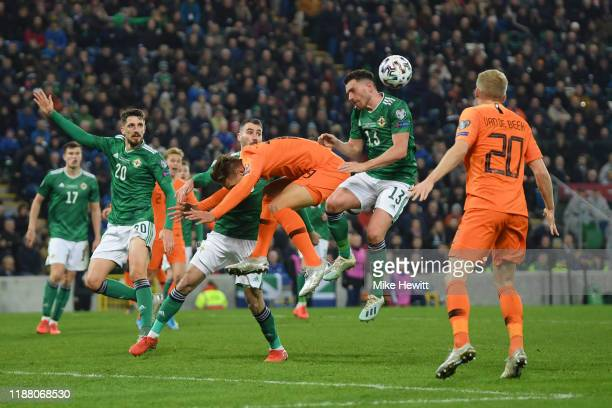 Luuk de Jong of Netherlands collides with Corry Evans of Northern Ireland during the UEFA Euro 2020 Group C Qualifier match between Northern Ireland...