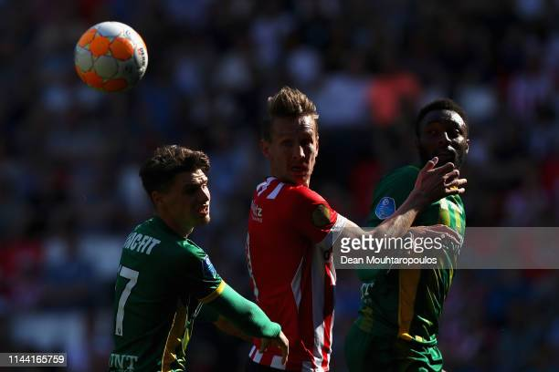 Luuk de Jong of PSV battles for the ball with Danny Bakker and Wilfried Kanon of ADO Den Haag during the Eredivisie match between PSV and ADO Den...