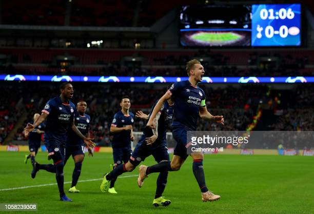 Luuk de Jong of PSV Eindhoven celebrates with team mates after scoring his team's first goal during the Group B match of the UEFA Champions League...