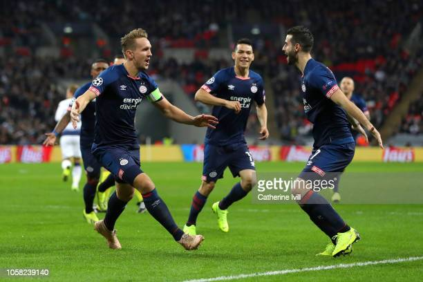 Luuk de Jong of PSV Eindhoven celebrates with teammates after scoring his team's first goal during the Group B match of the UEFA Champions League...
