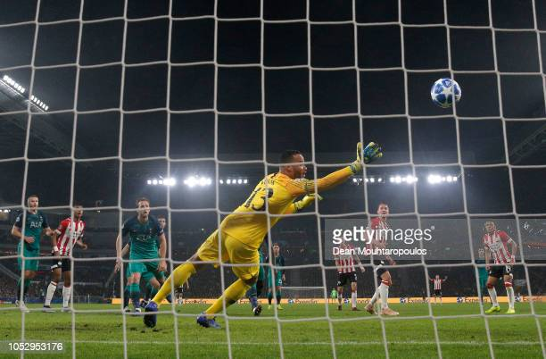 Luuk de Jong of PSV Eindhoven scores his team's second goal past Michel Vorm of Tottenham Hotspur during the Group B match of the UEFA Champions...