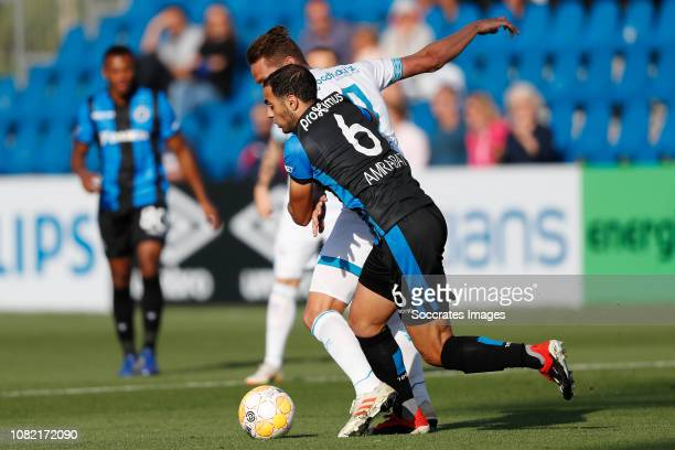 Luuk de Jong of PSV Sofyan Amrabat of Club Brugge during the Club Friendly match between PSV v Club Brugge on January 11 2019 in Doha Qatar