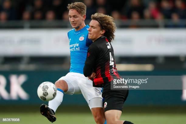Luuk de Jong of PSV Wout Faes of Excelsior during the Dutch Eredivisie match between Excelsior v PSV at the Van Donge De Roo Stadium on November 26...