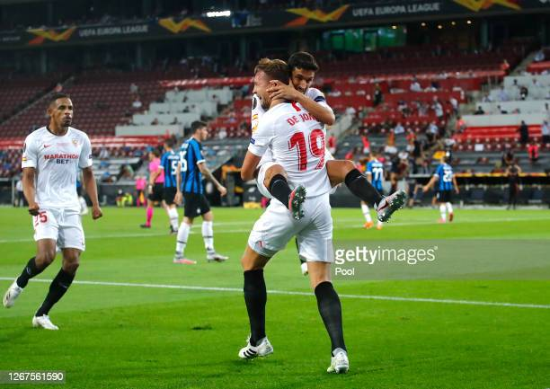 Luuk de Jong of Sevilla celebrates with teammate Jesus Navas after scoring his team's first goal during the UEFA Europa League Final between Seville...