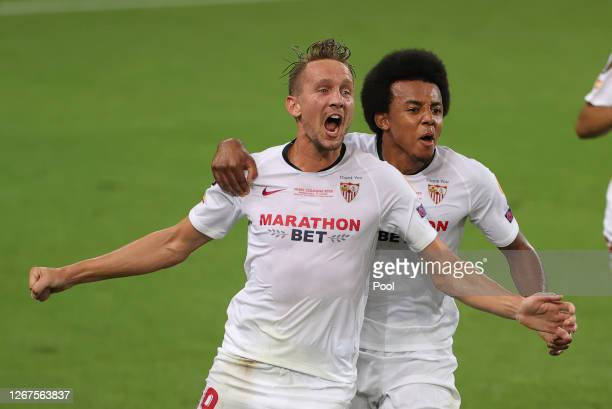 Luuk de Jong of Sevilla celebrates with teammate Jules Kounde after scoring his team's second goal during the UEFA Europa League Final between...