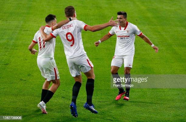Luuk de Jong of Sevilla FC celebrates with his team mates after scoring his sides first goal during the UEFA Champions League Group E stage match...