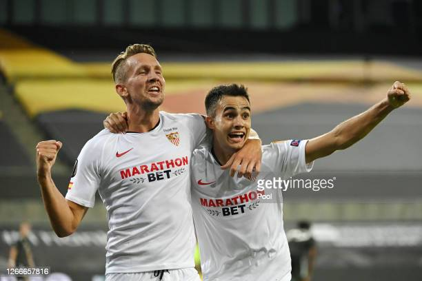 Luuk de Jong of Sevilla FC celebrates with Sergio Reguilon after scoring his team's second goal during the UEFA Europa League Semi Final between...