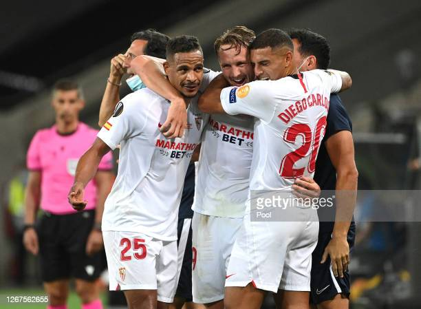 Luuk de Jong of Sevilla FC celebrates with teammates Fernando and Diego Carlos after scoring his team's second goal during the UEFA Europa League...